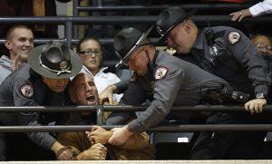 Heckler being arrested